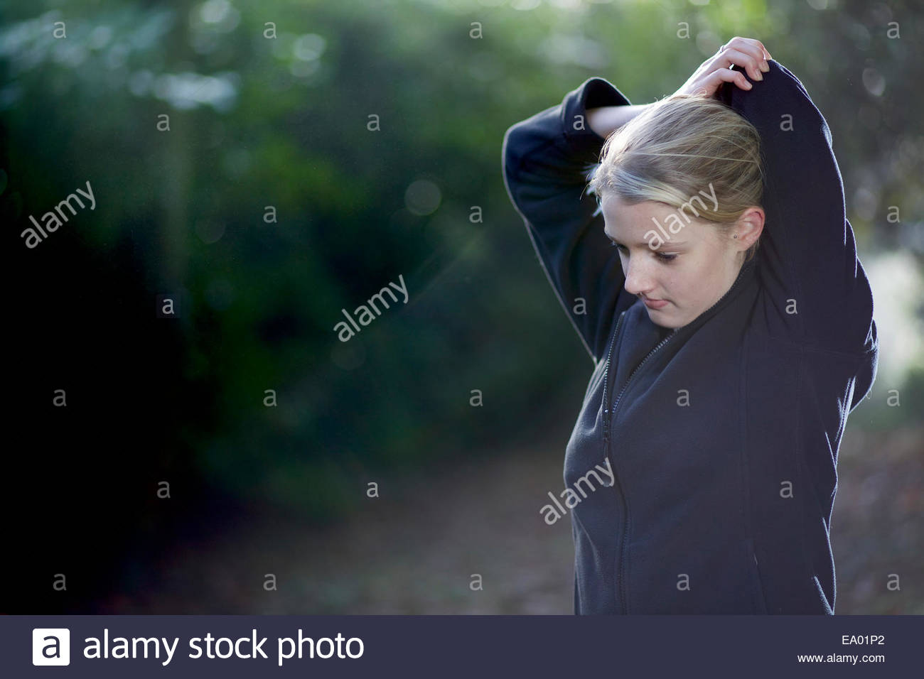 Woman stretching in woods Photo Stock