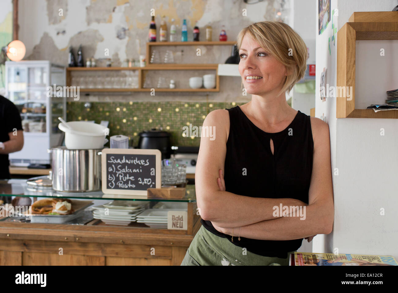 Mid adult woman in cafe Photo Stock