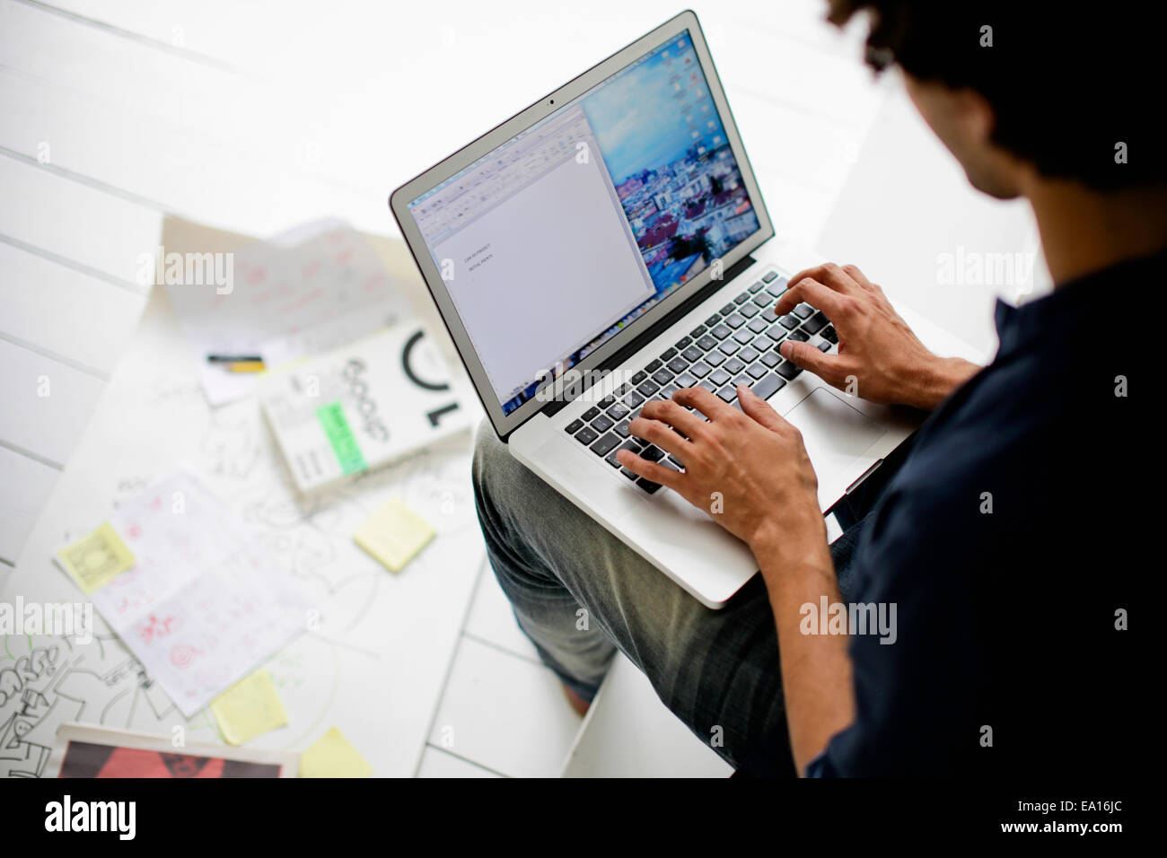 Graphic Designer using laptop Photo Stock