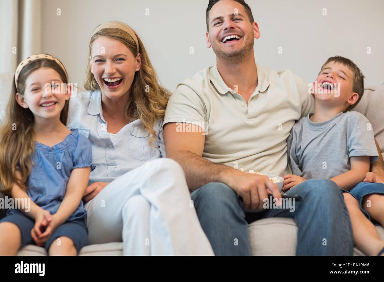 Happy Family sitting on sofa Photo Stock