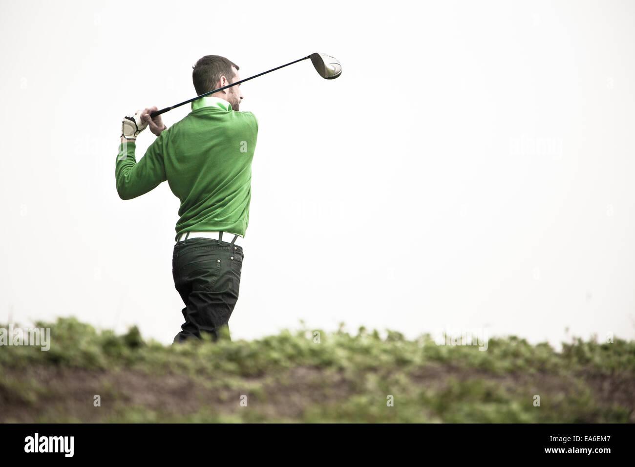 Man playing golf Photo Stock