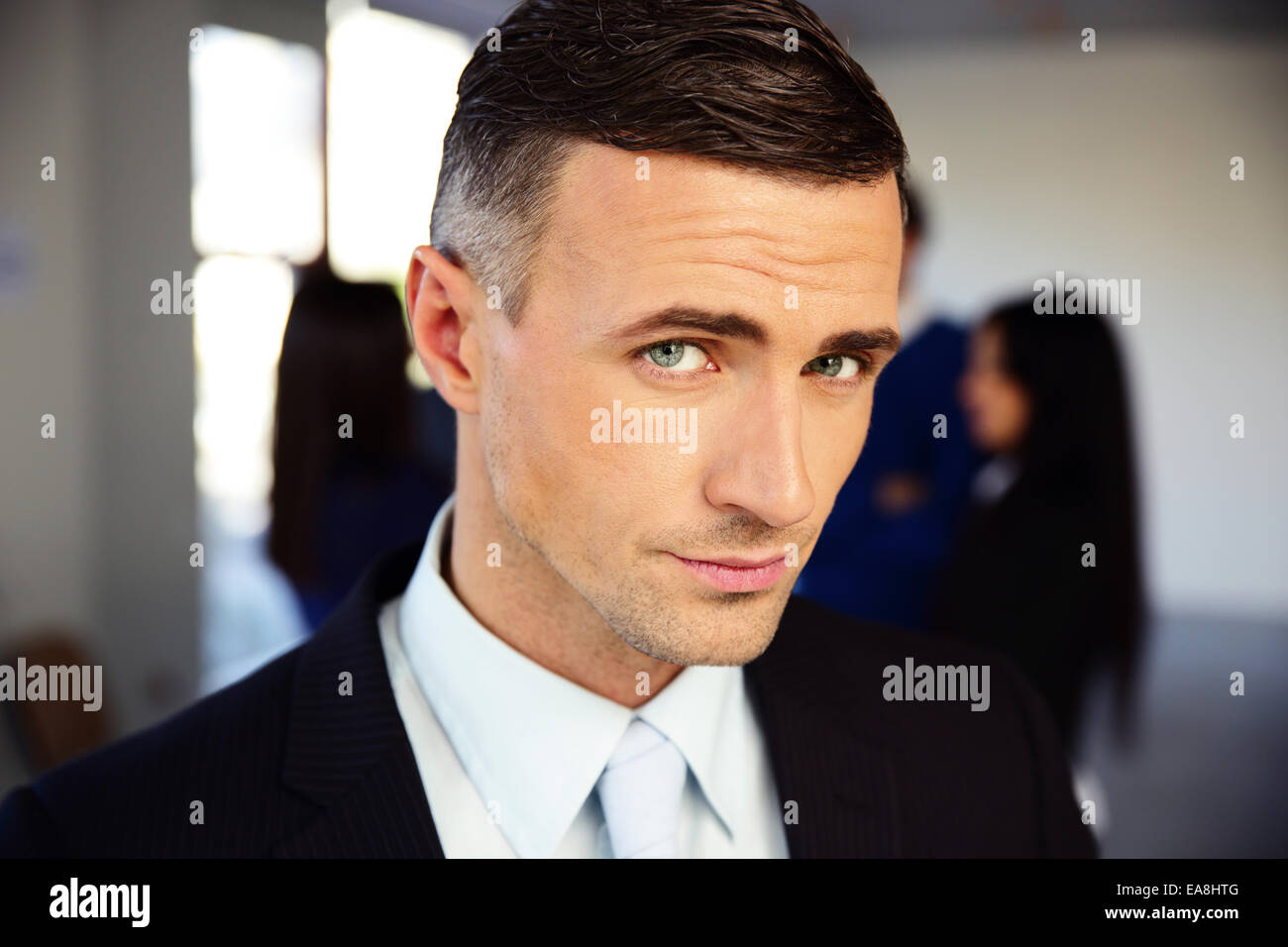 Portrait of a handsome serious businessman Photo Stock