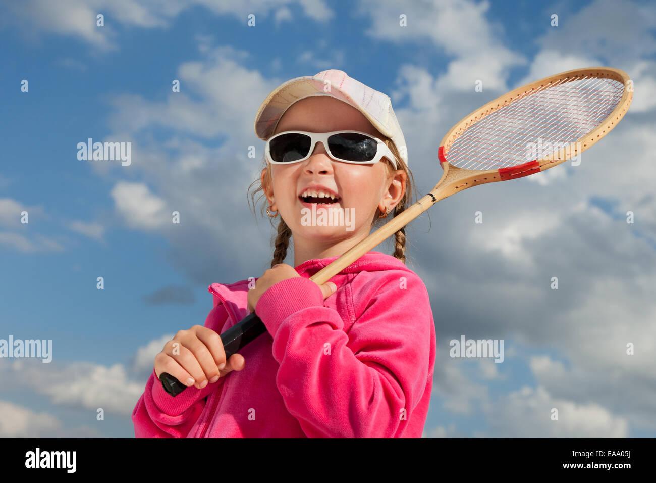Petite fille avec pour raquette badminton Banque D'Images