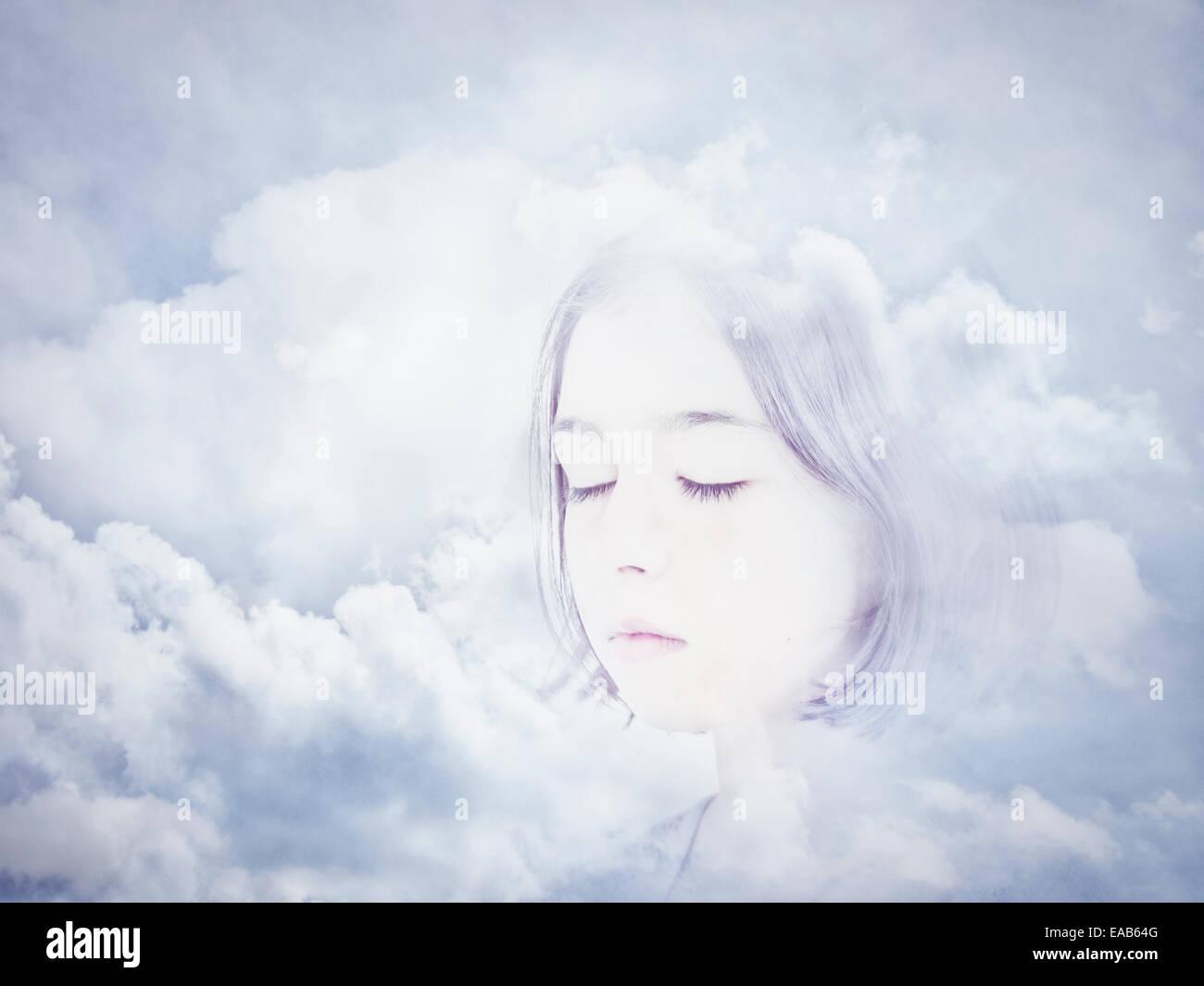 Visage dans les nuages. Composite numérique. Banque D'Images