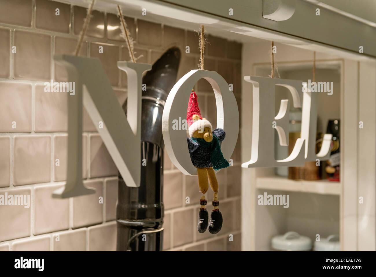 Lettres en bois l'orthographe du mot NOEL acheté de John Lewis Photo Stock