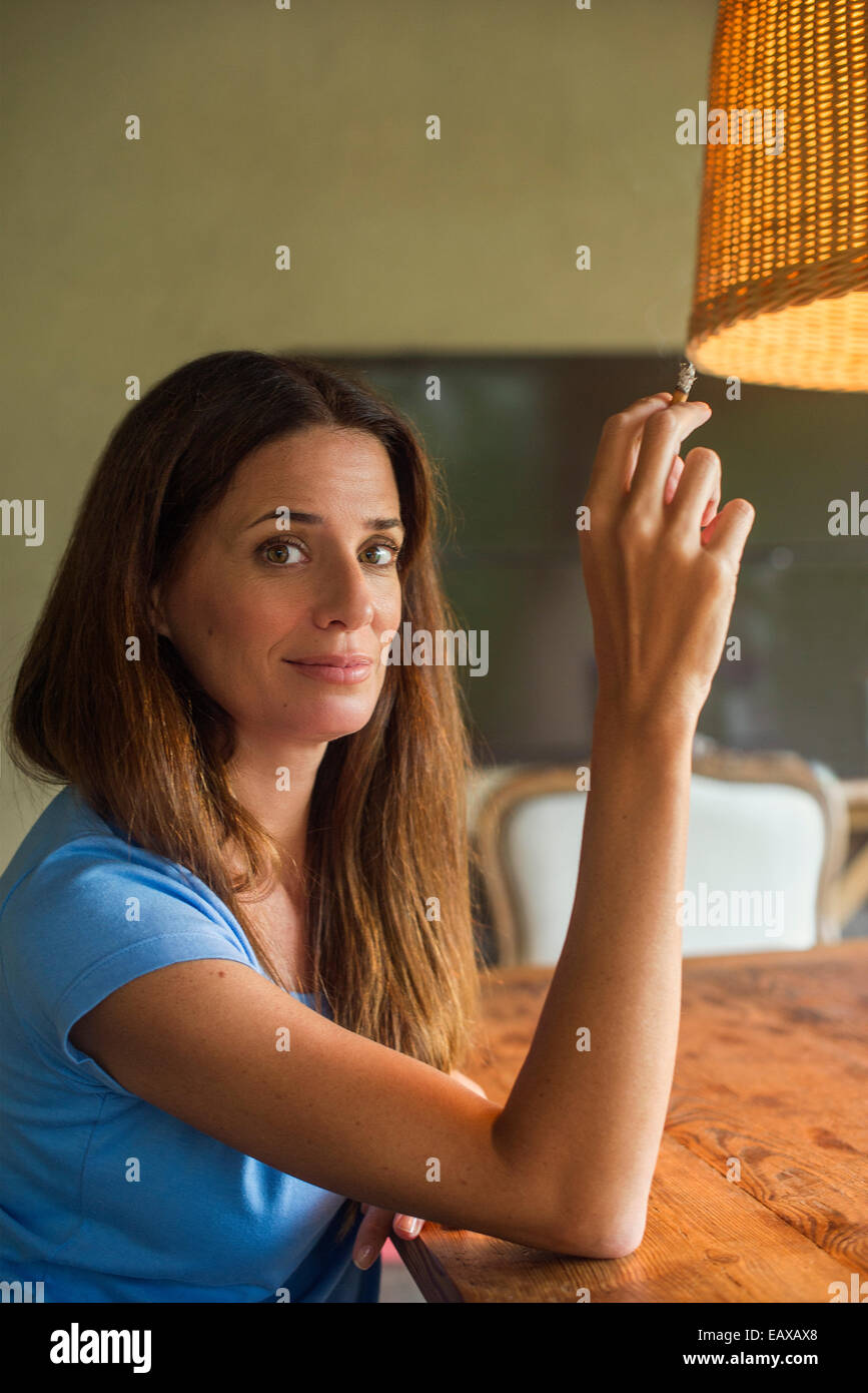 Woman relaxing with cigarette Photo Stock