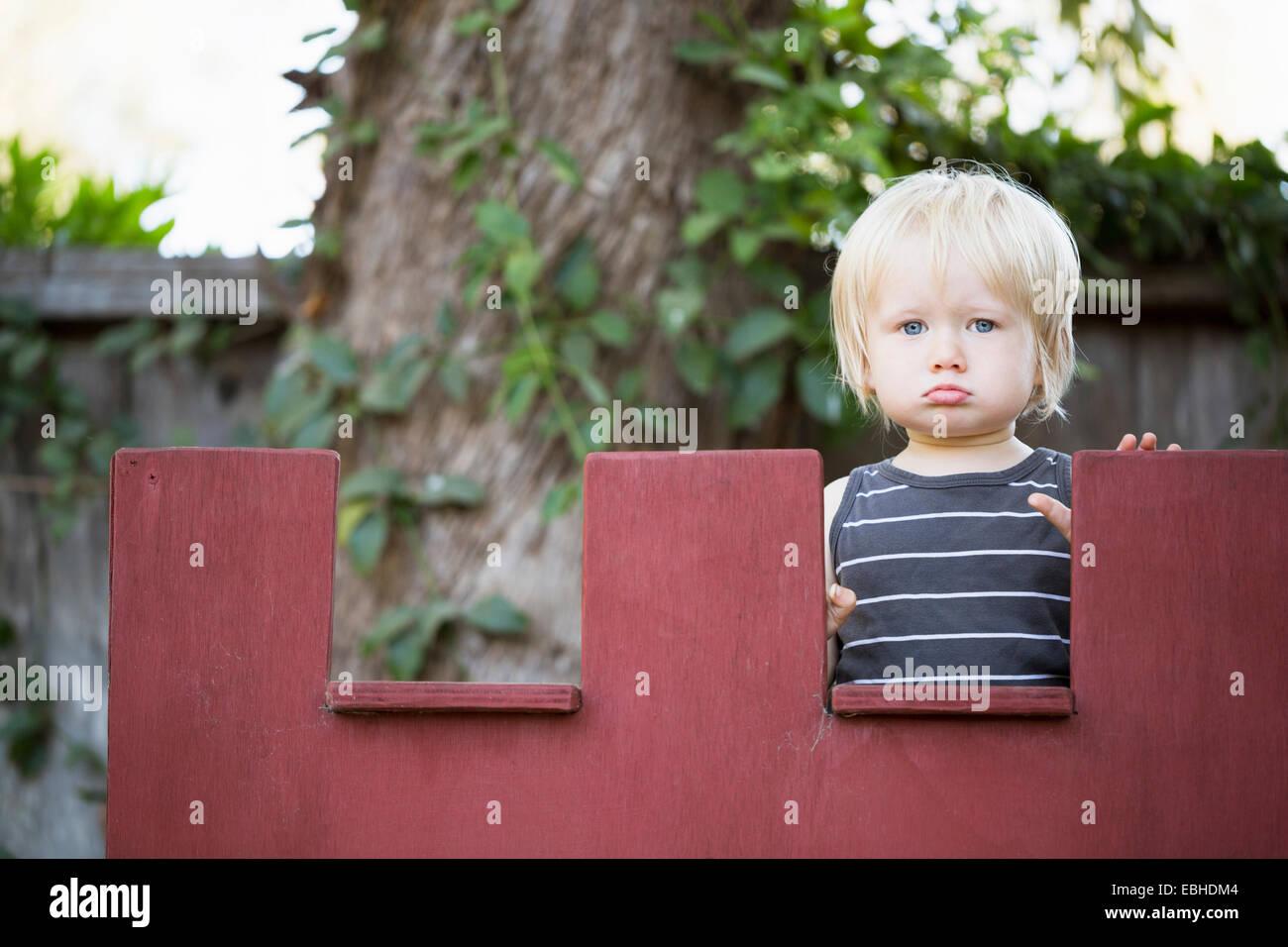 Jeune garçon bouder Photo Stock