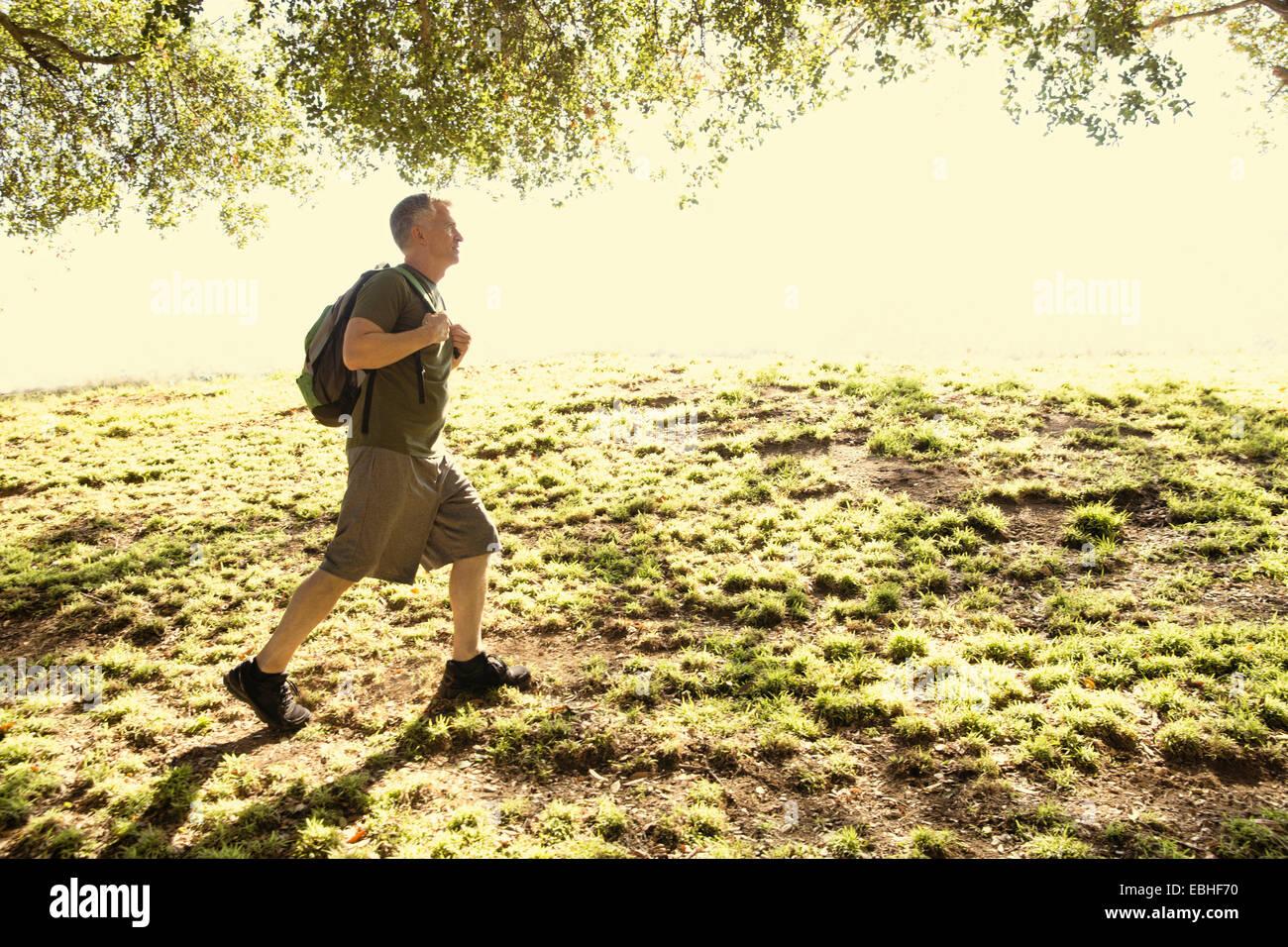 Man power walking in park Photo Stock