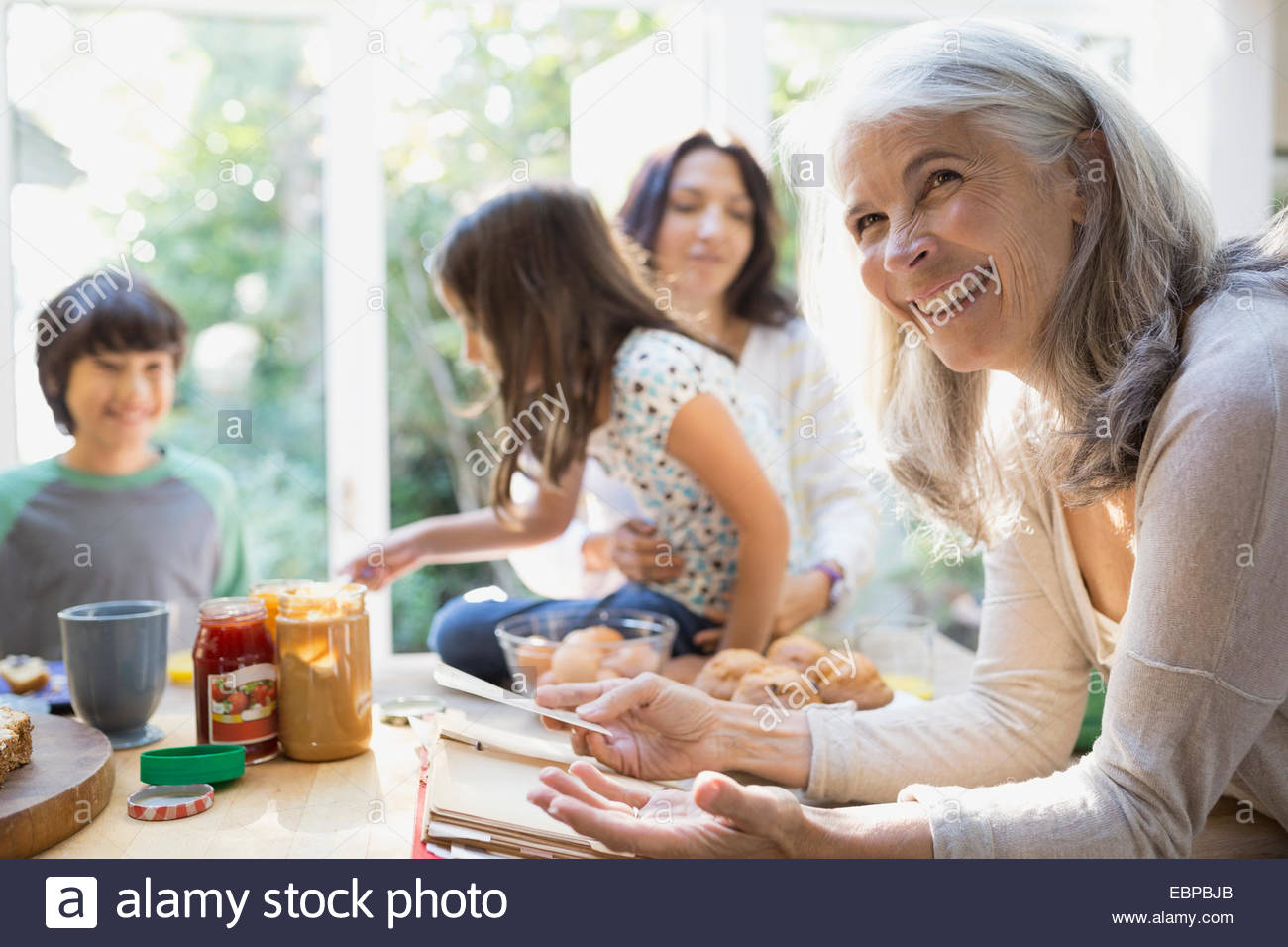 Multi-generation family in kitchen Photo Stock