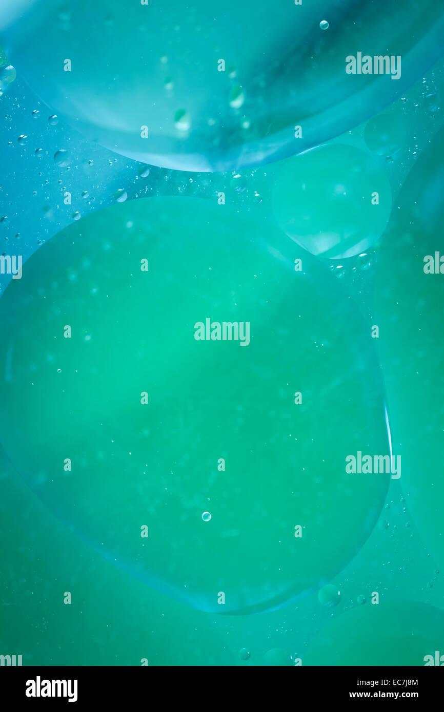 Résumé fond bleu vert cercles gouttelettes Photo Stock