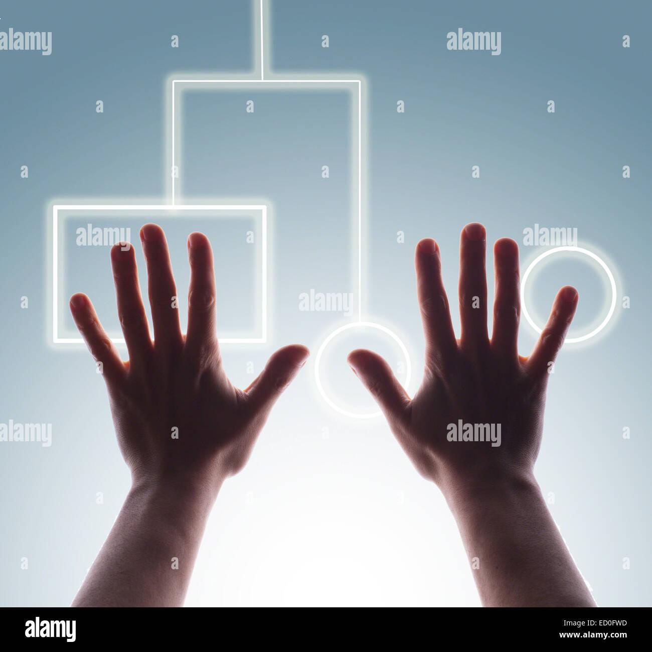 Studio shot of man's hands de toucher les boutons de l'écran tactile numérique Banque D'Images