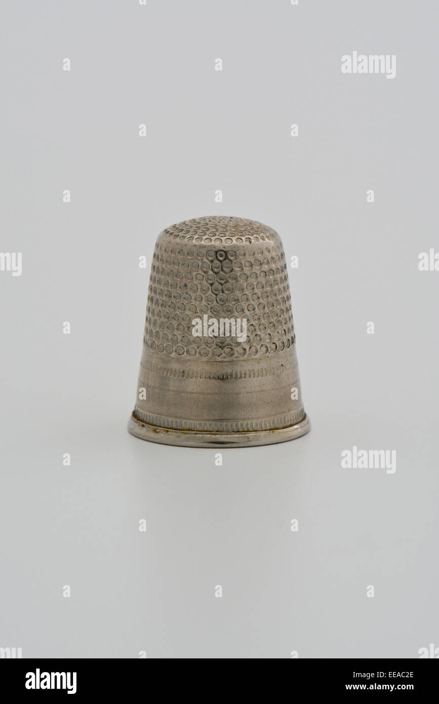 Close up of silver metal dé against white background Photo Stock
