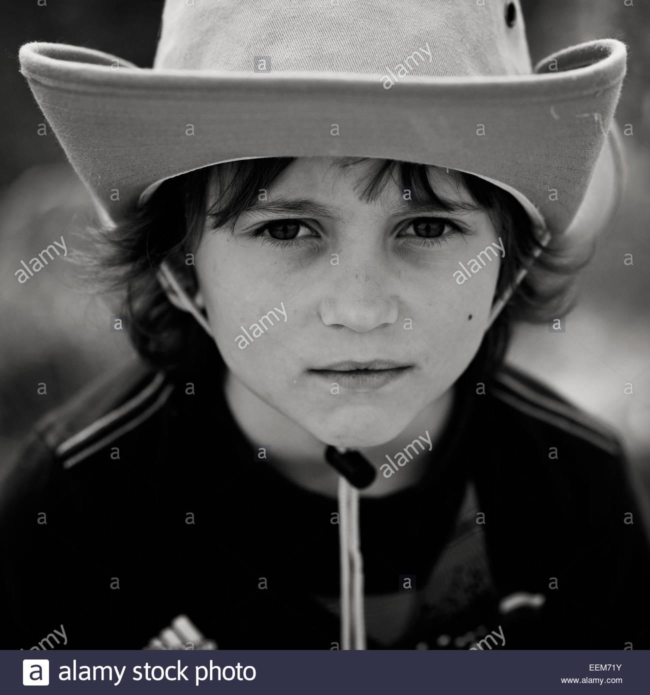 Portrait of boy (6-7) wearing cowboy hat Photo Stock