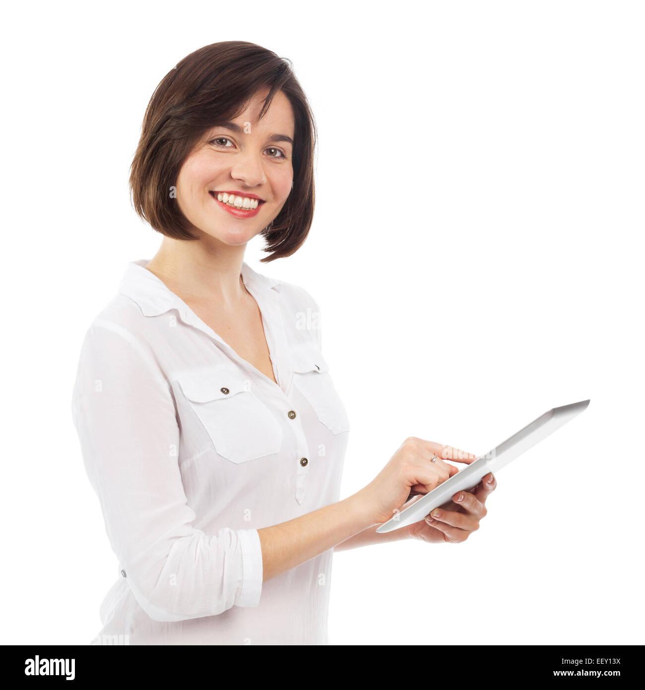 Jeune femme à l'aide d'un pavé tactile, isolated on white Photo Stock