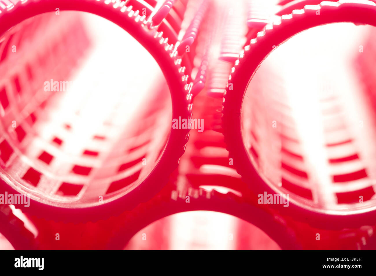 Résumé fond rose de fers à friser Photo Stock