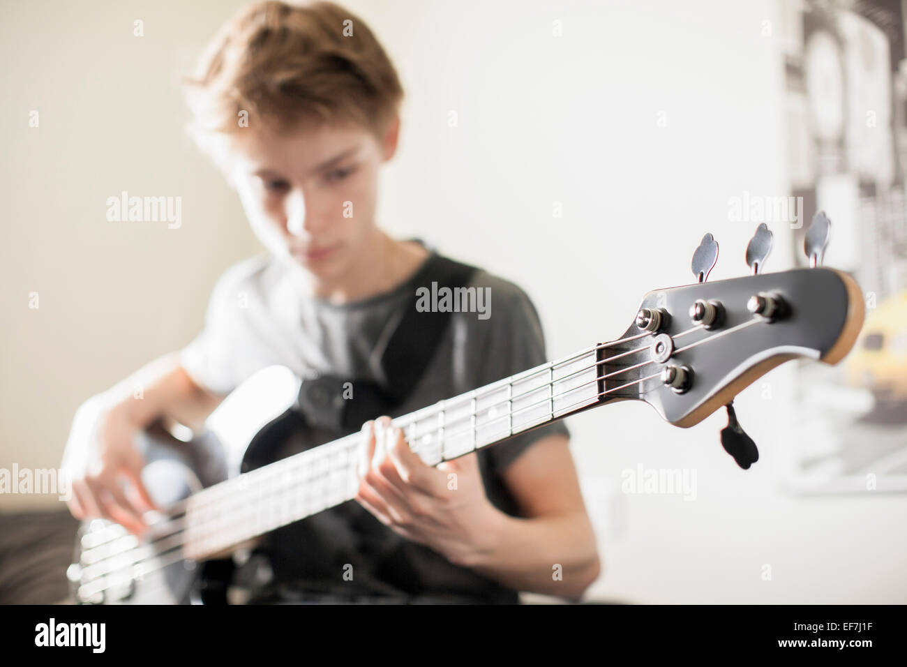 Teenage boy playing guitar Photo Stock