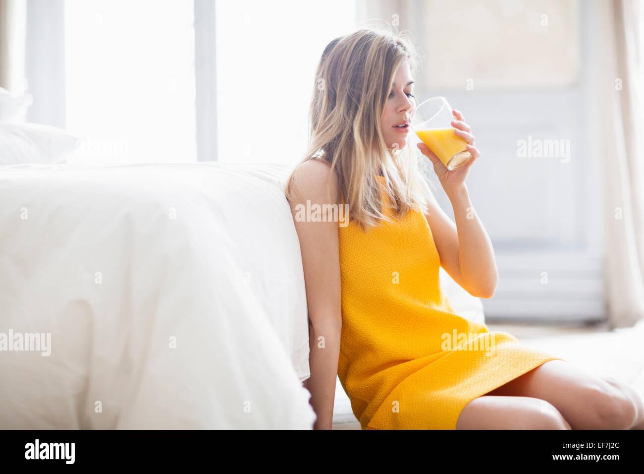 Woman drinking orange juice Photo Stock