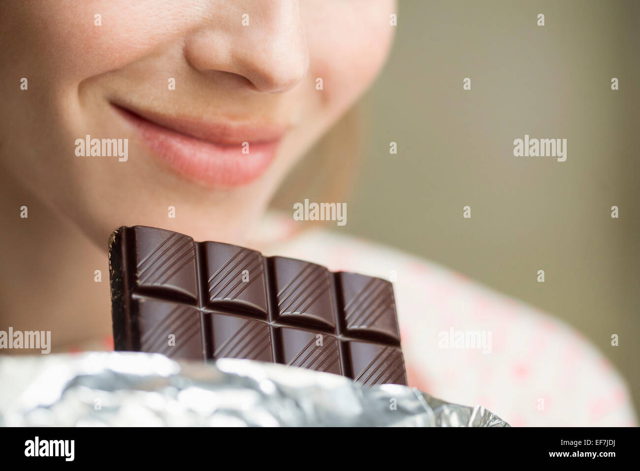 Woman eating a chocolate Photo Stock
