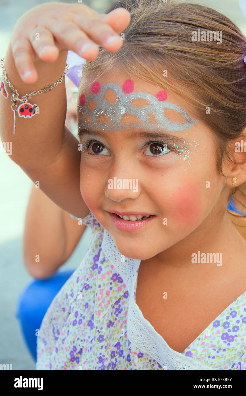 Girl (6-7) with face paint Photo Stock