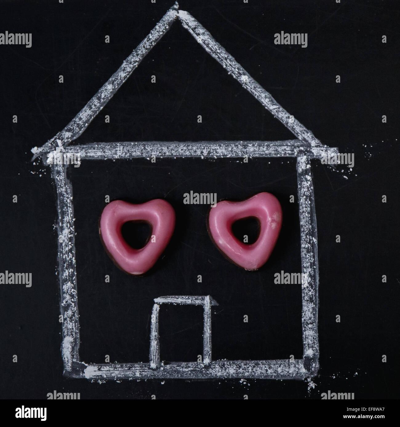 Maison peinte avec des bonbons windows Photo Stock