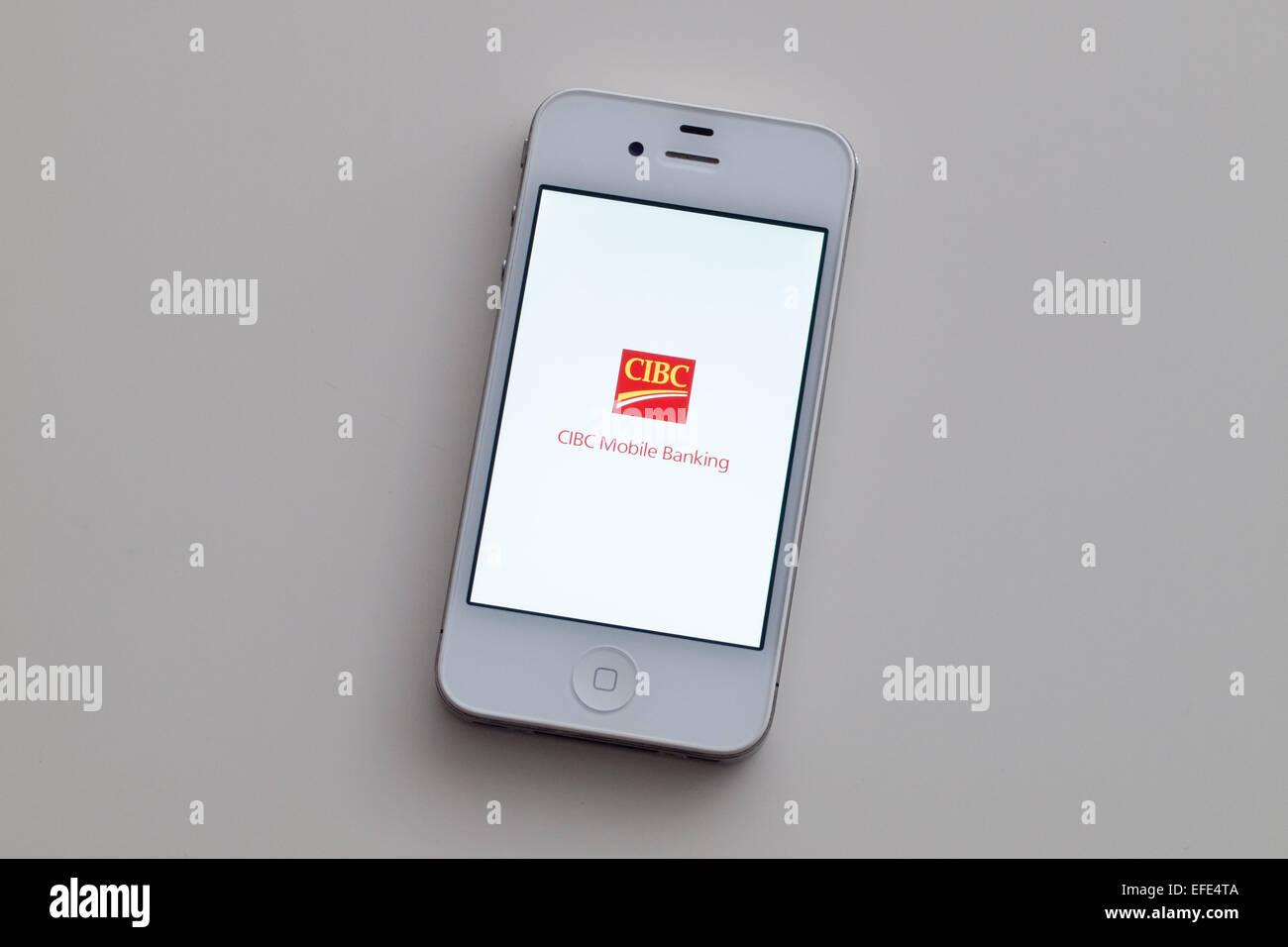 Une vue de l'emblème et du logo de la Banque Canadienne Impériale de Commerce (CIBC) application mobile banking Banque D'Images