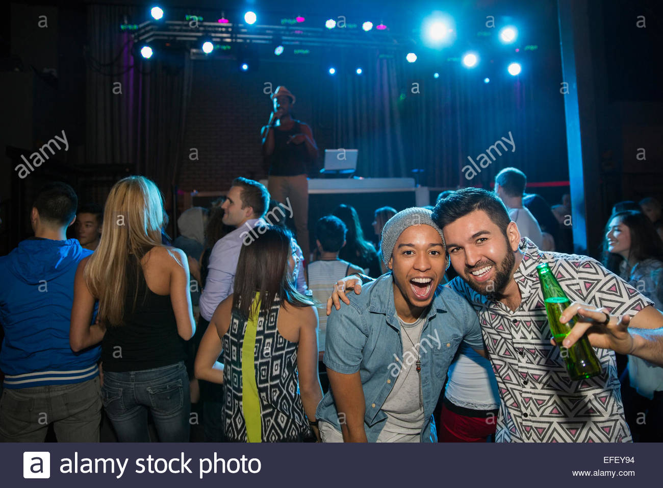 Portrait of smiling men at nightclub Banque D'Images