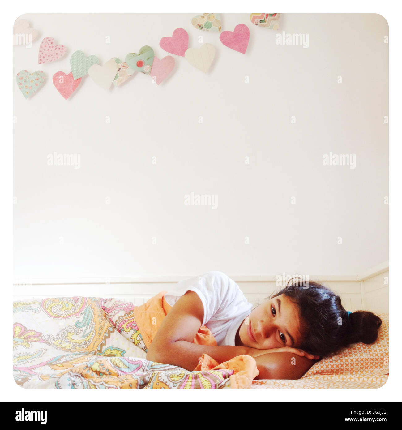 Girl Lying in Bed Photo Stock