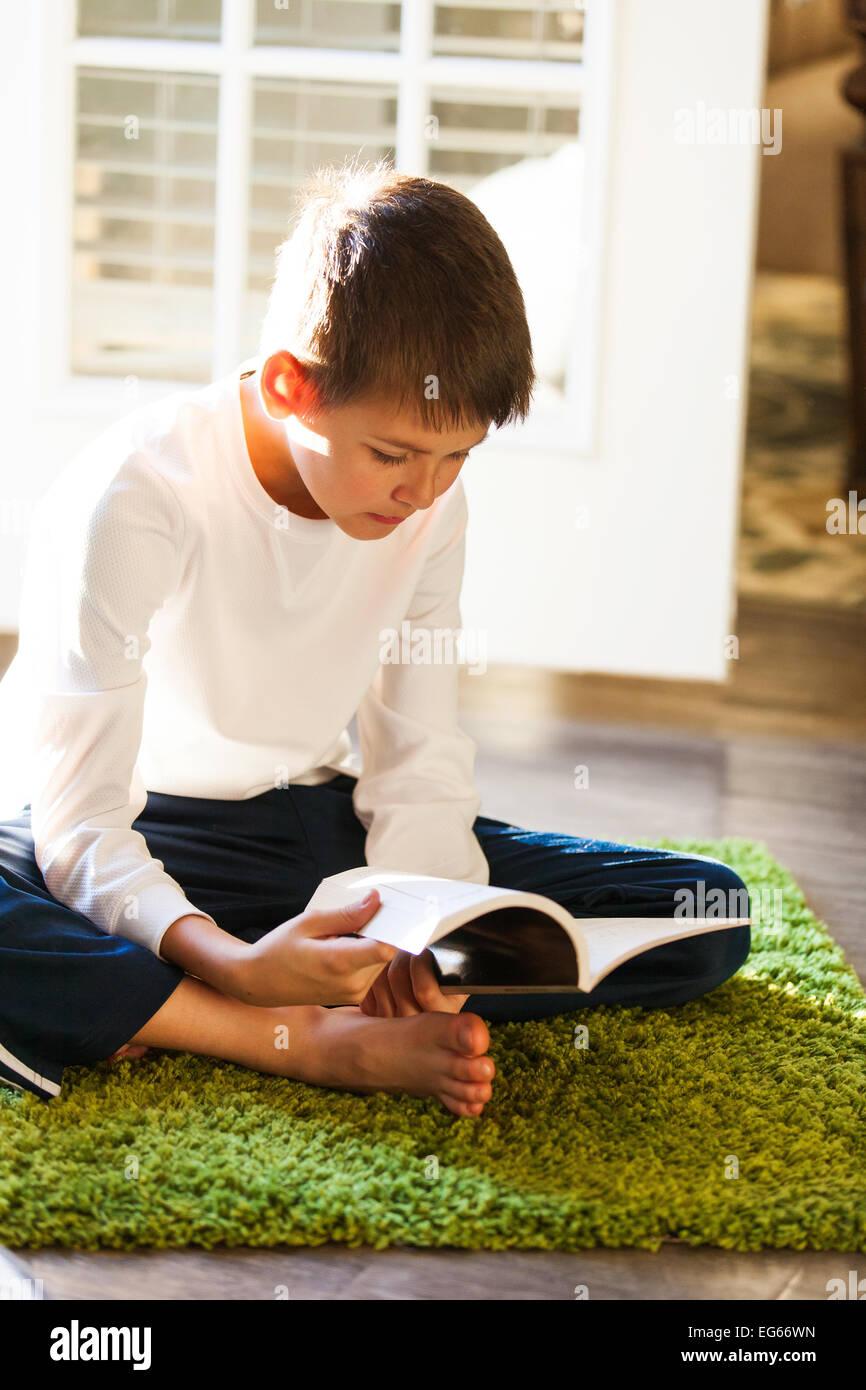 Boy reading a book Photo Stock