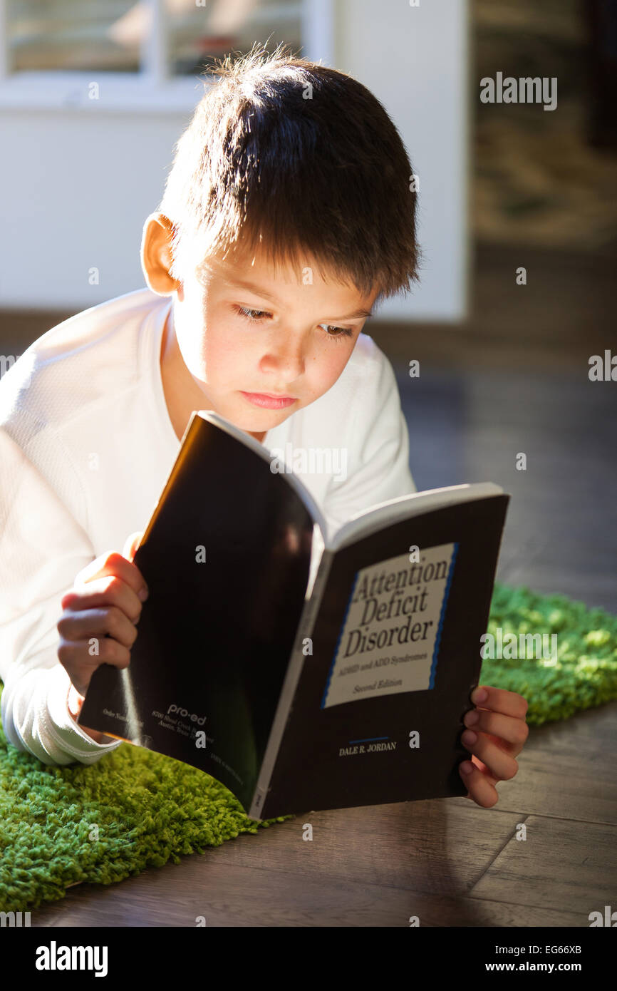 Boy reading a book Photo Stock