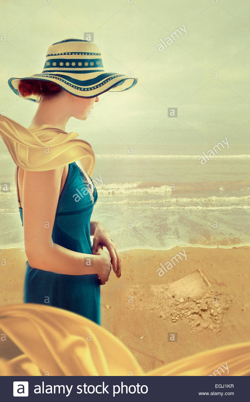 Young woman standing on beach Photo Stock