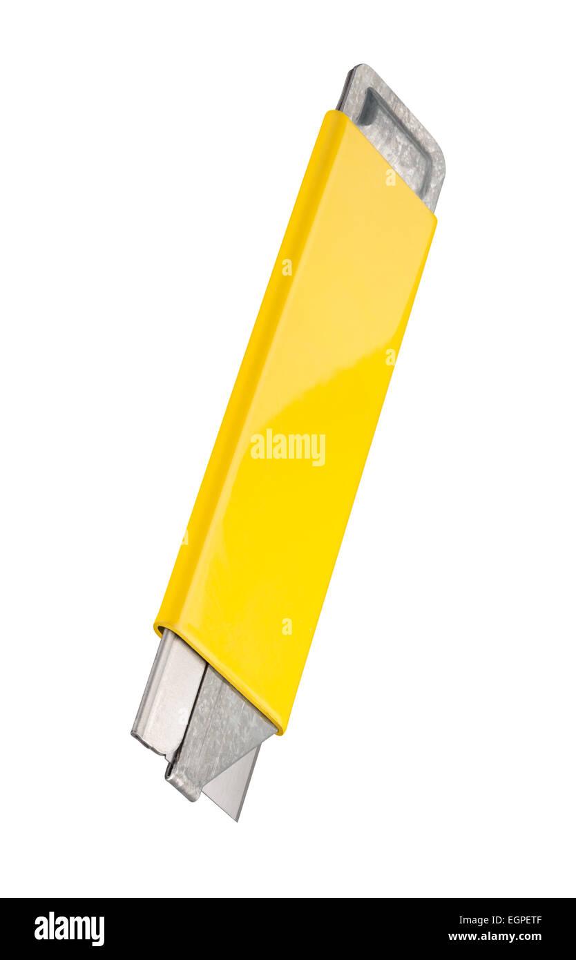 Vintage yellow box cutter avec une lame rétractable. Photo Stock