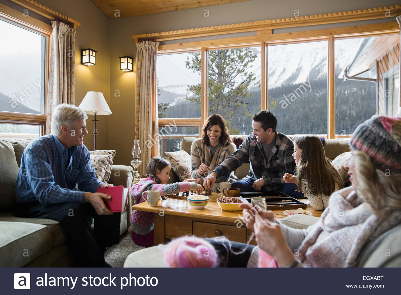 Multi-generation family relaxing in living room Photo Stock