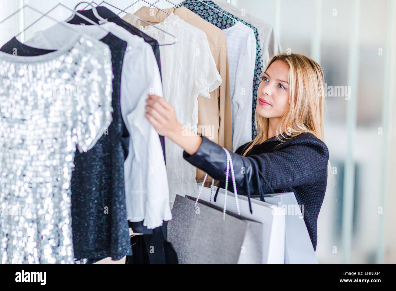 Woman shopping in cloth shop. Photo Stock