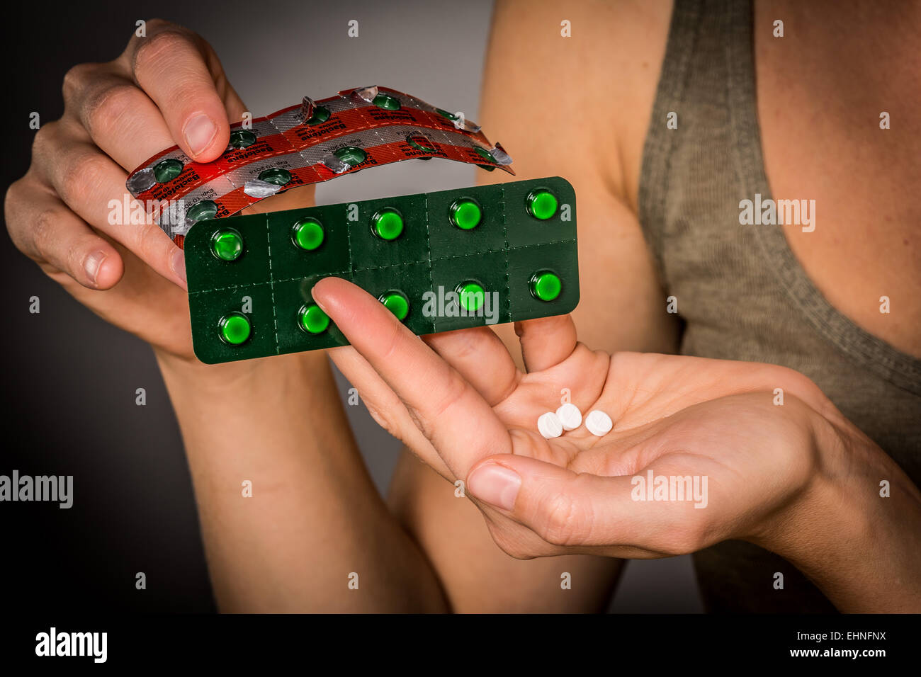 Woman taking Baclofene® comprimés. Photo Stock