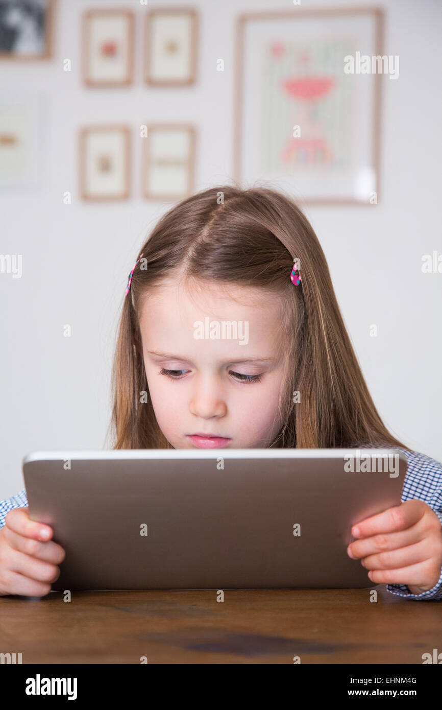 5 year-old girl using tablet computer. Photo Stock