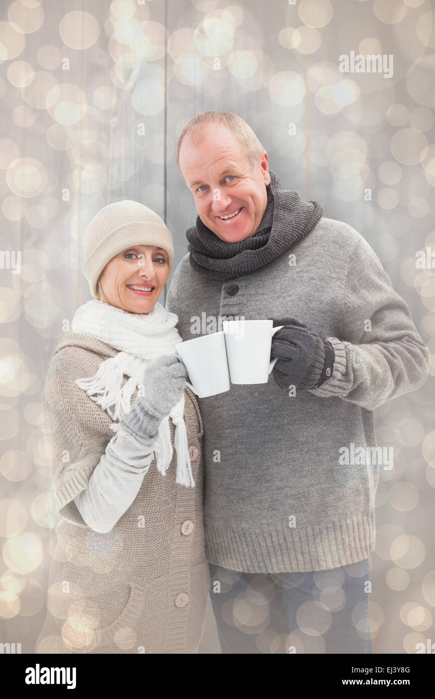 Image composite de mature woman in winter clothes holding mugs Photo Stock 36afd8864f2