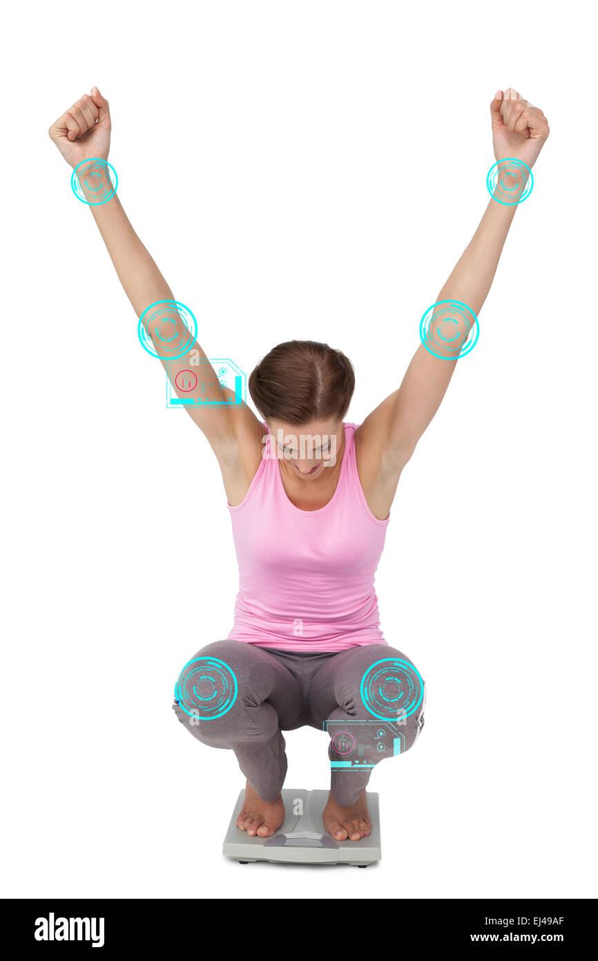 Composite image d'une jeune femme en train d'encourager l'échelle de poids Banque D'Images