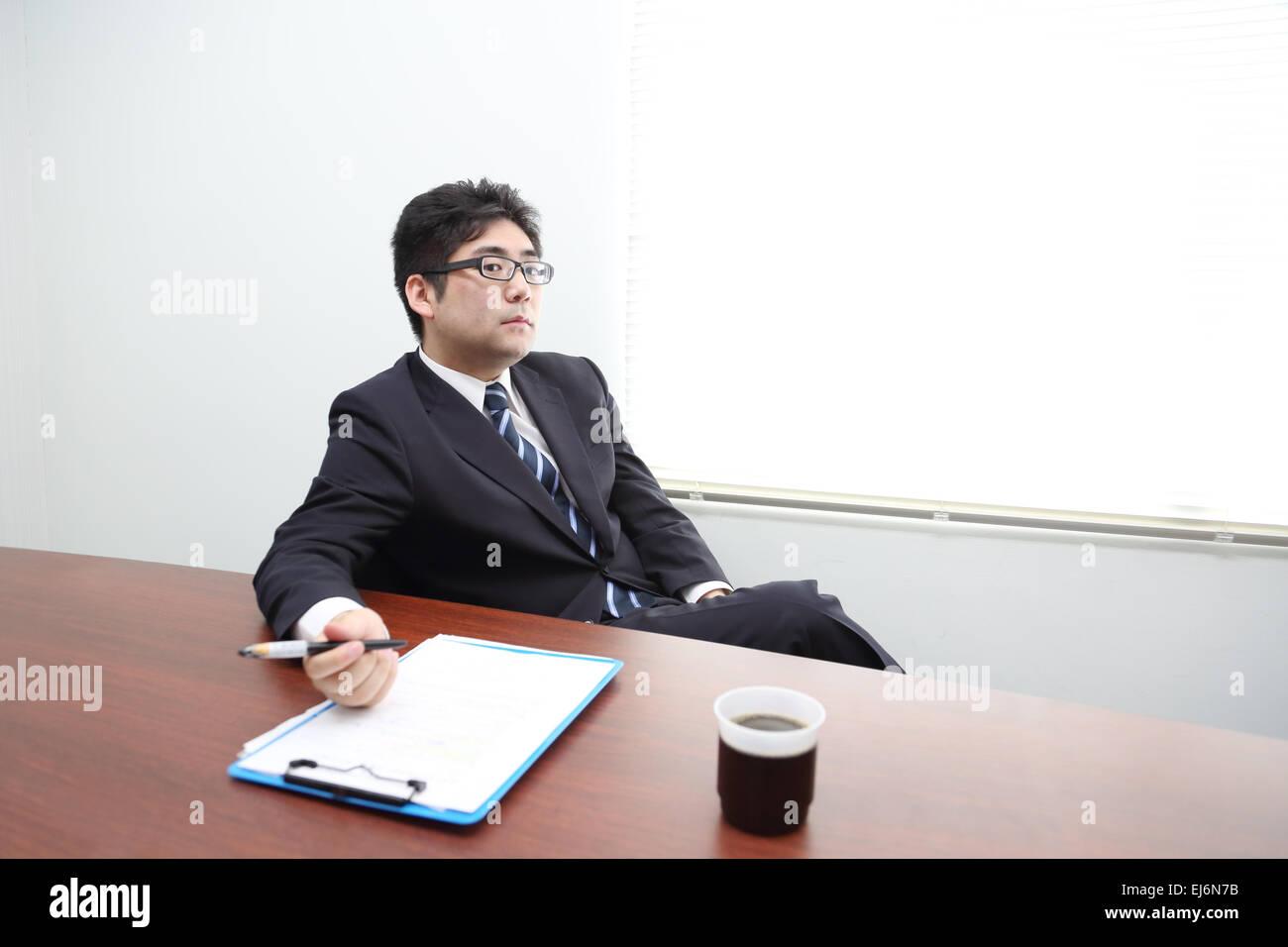 Patron japonais dans le bureau banque dimages photo stock
