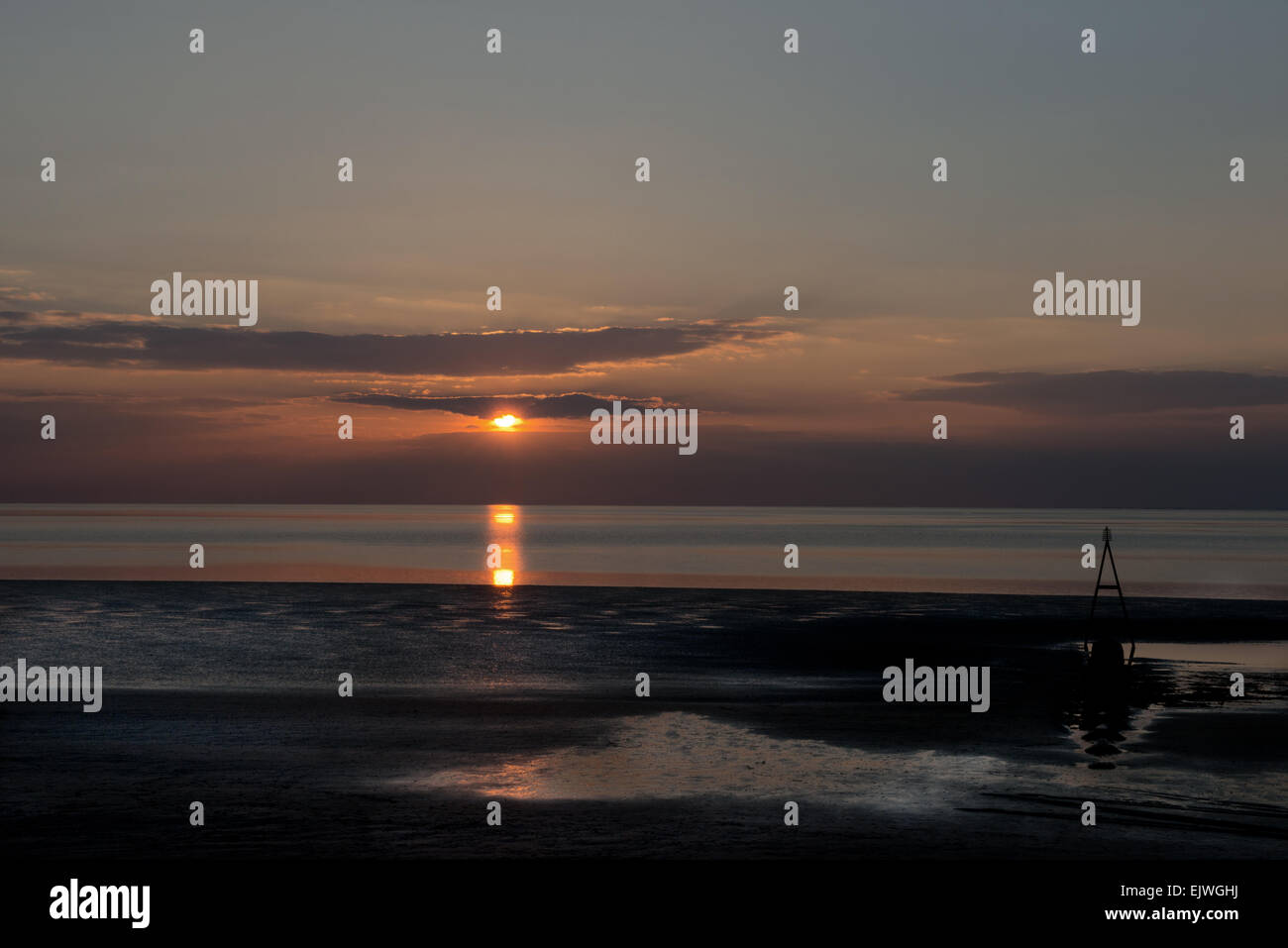 Un coucher de soleil sur plage de Hunstanton, côte nord de Norfolk, England, UK, FR Photo Stock