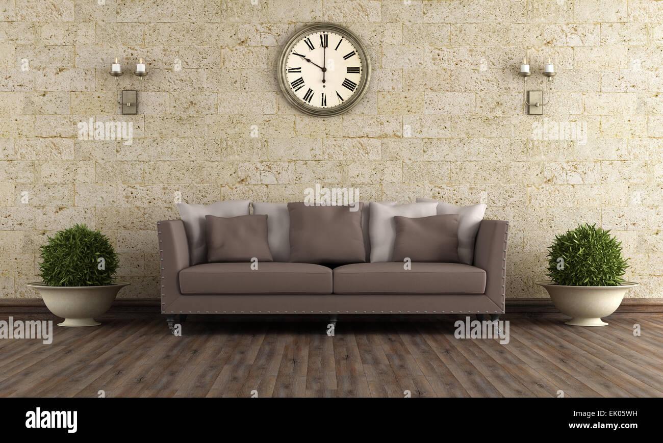 Classic salon avec canapé marron contre le mur de pierre ...