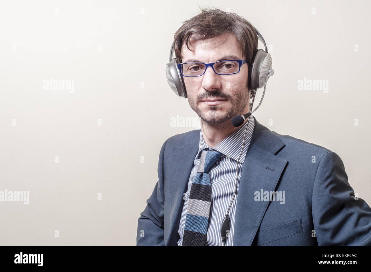 Businessman avec casque et microphone Photo Stock