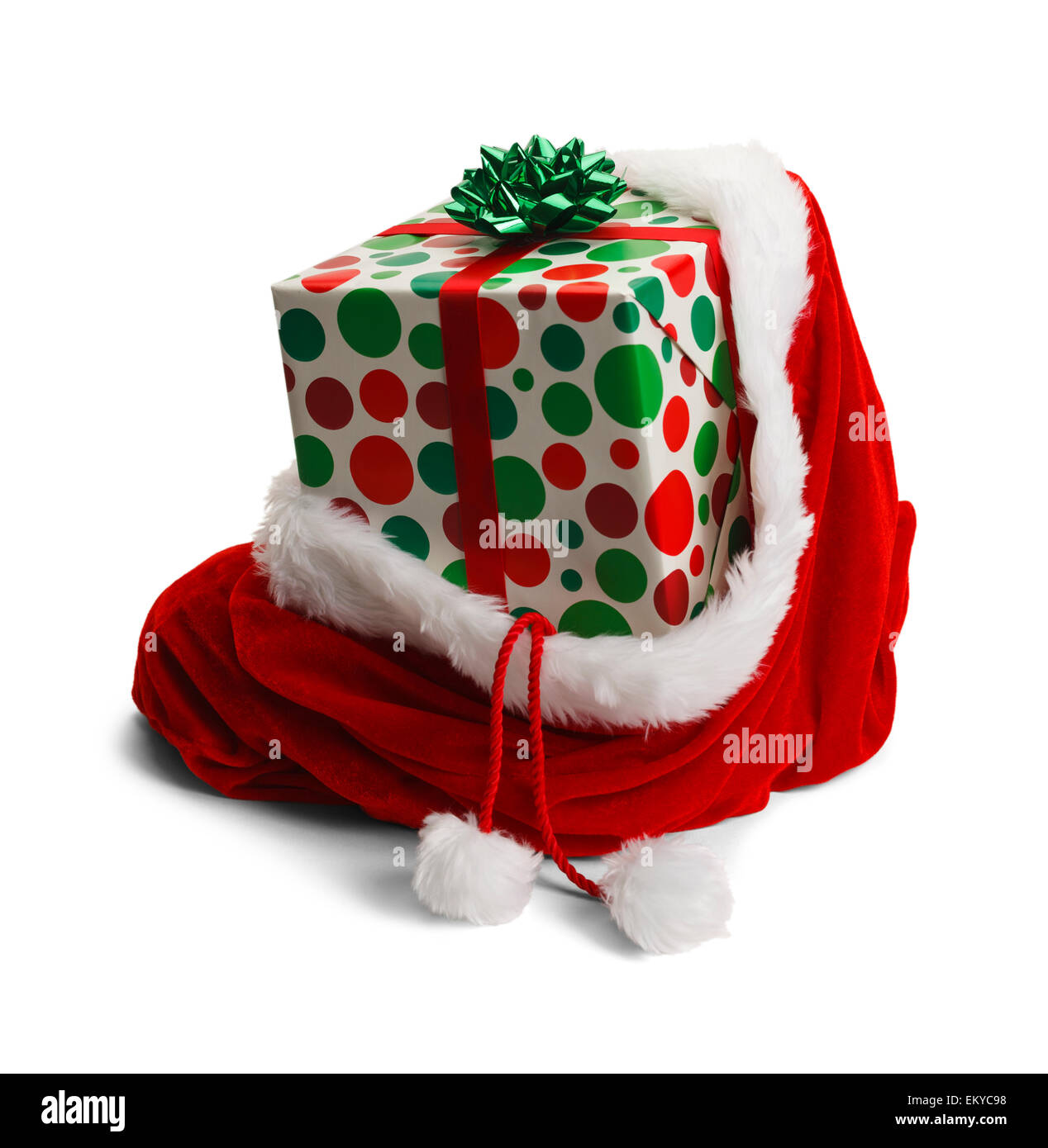Santa sac avec un dernier présent isolé sur fond blanc. Photo Stock