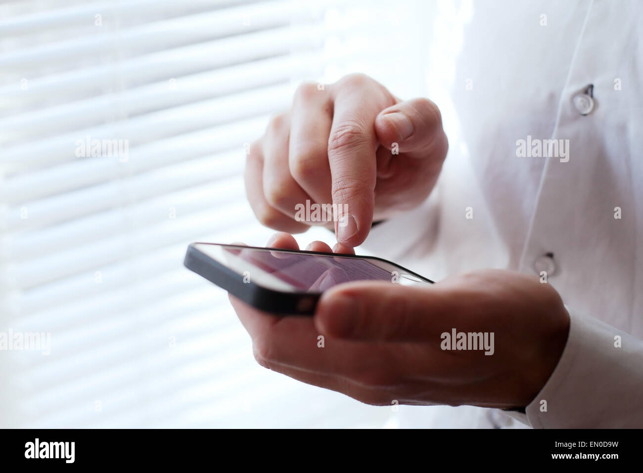 Business man using smartphone Photo Stock