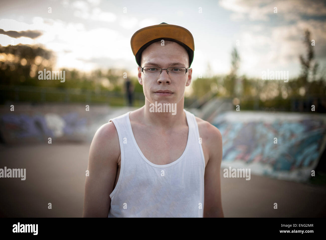 Caucasian man standing at skate park Photo Stock