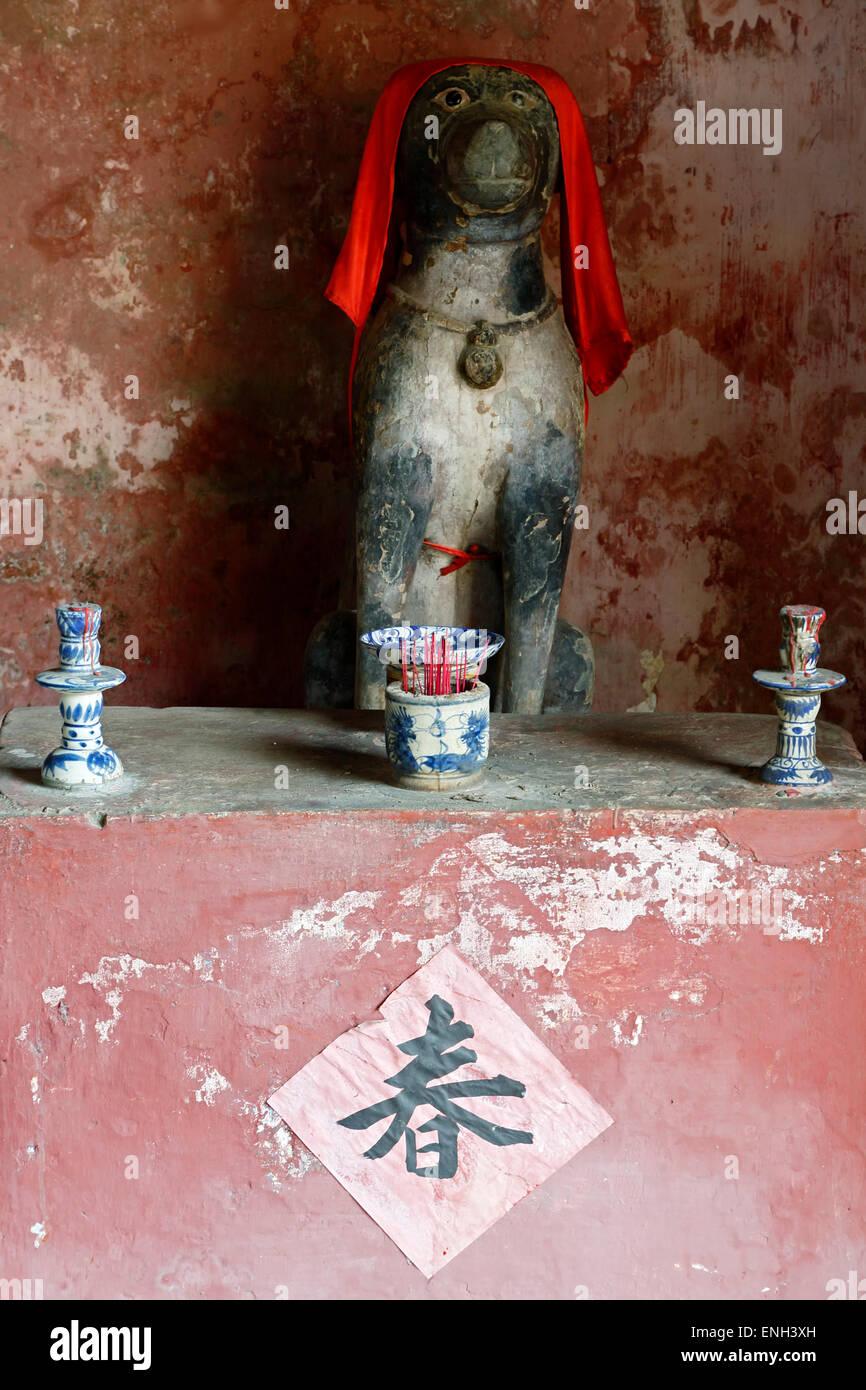 Chien de culte, le pont couvert japonais, Hoi an, Vietnam Photo Stock