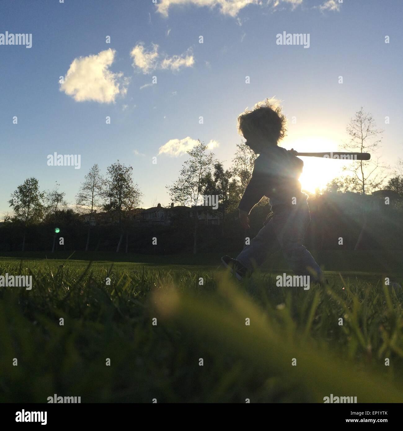 Boy Playing with baseball bat Photo Stock