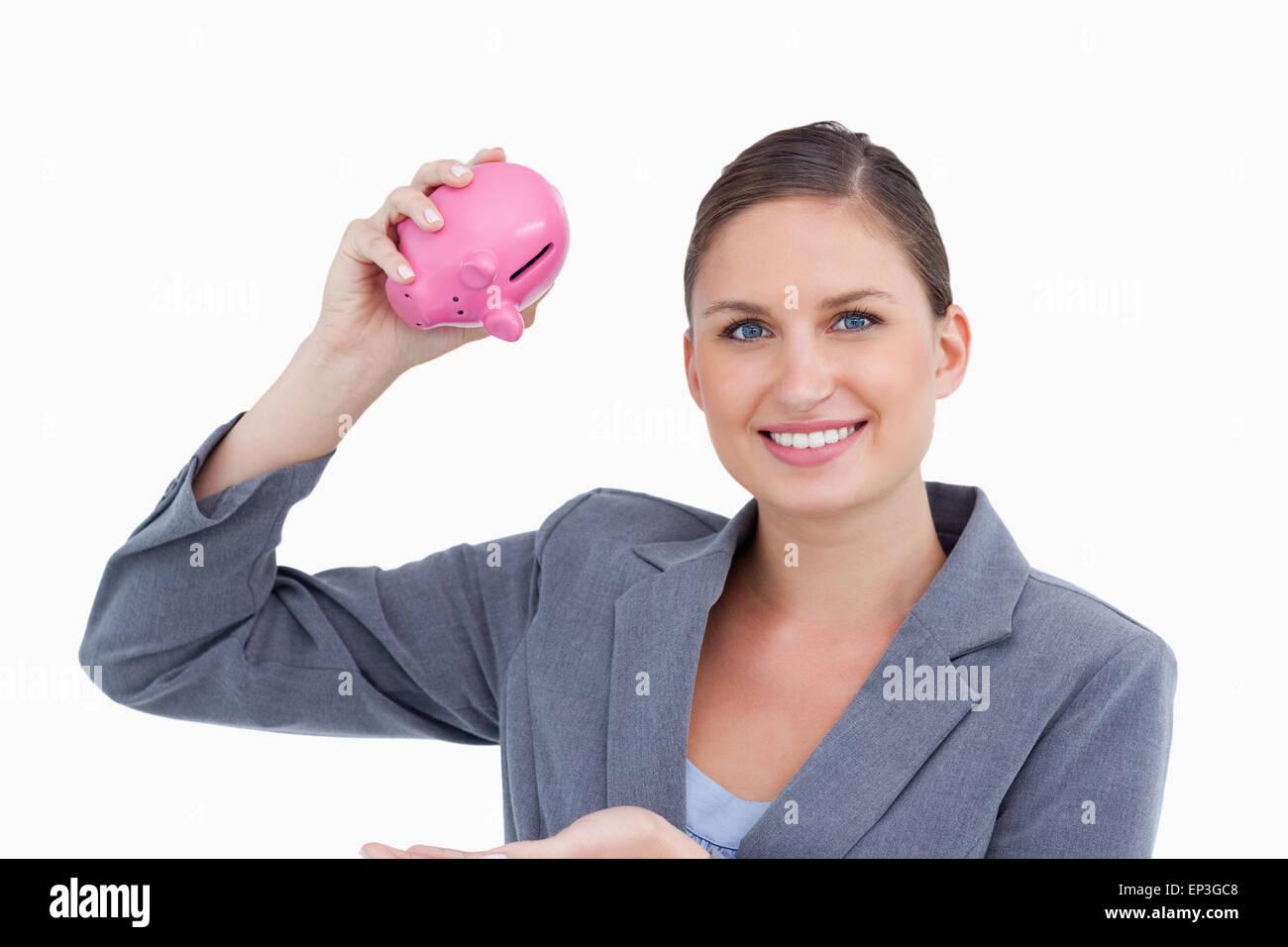 Smiling employé de banque avec tirelire dans sa main Photo Stock