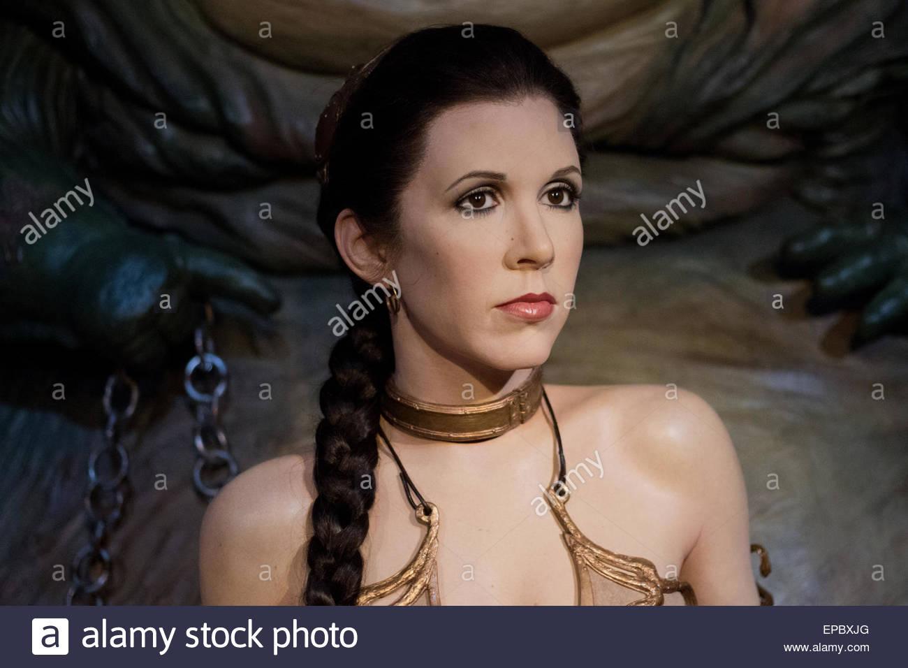 Princesse Leia enchaîné dans son bikini doré par Jabba le Hutt Photo Stock