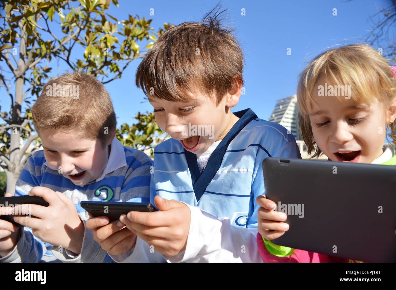 Kids with smartphone Photo Stock