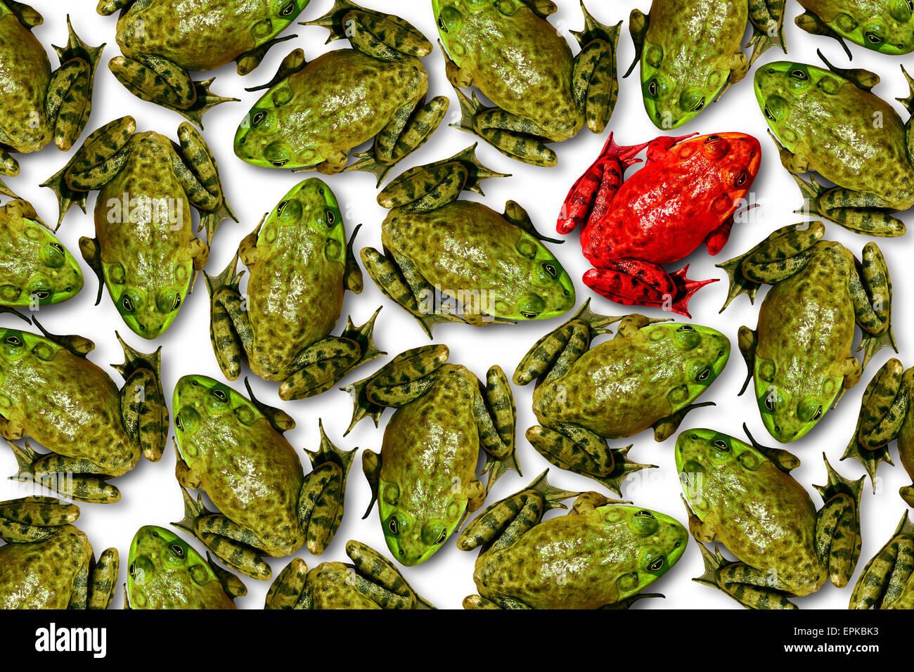 Concept d'individualité comme un groupe de grenouilles vertes avec un individu comme une grenouille rouge Photo Stock